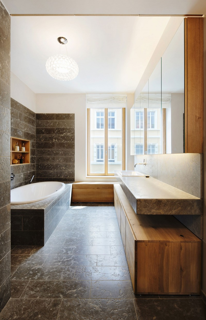 Bathroom Interior Featured with Patented Bathtub and Floating Wooden Vanity