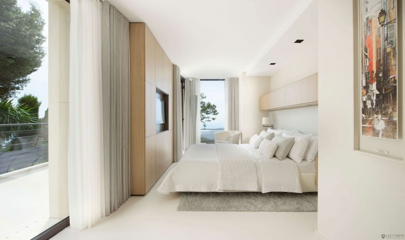 Bedroom Interior Featured with Wooden TV Stand and Transparency on the Wall with Curtain