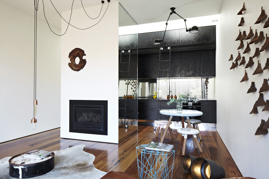 Black Kitchen Counter and Small Dining Space on Hardwood Floor