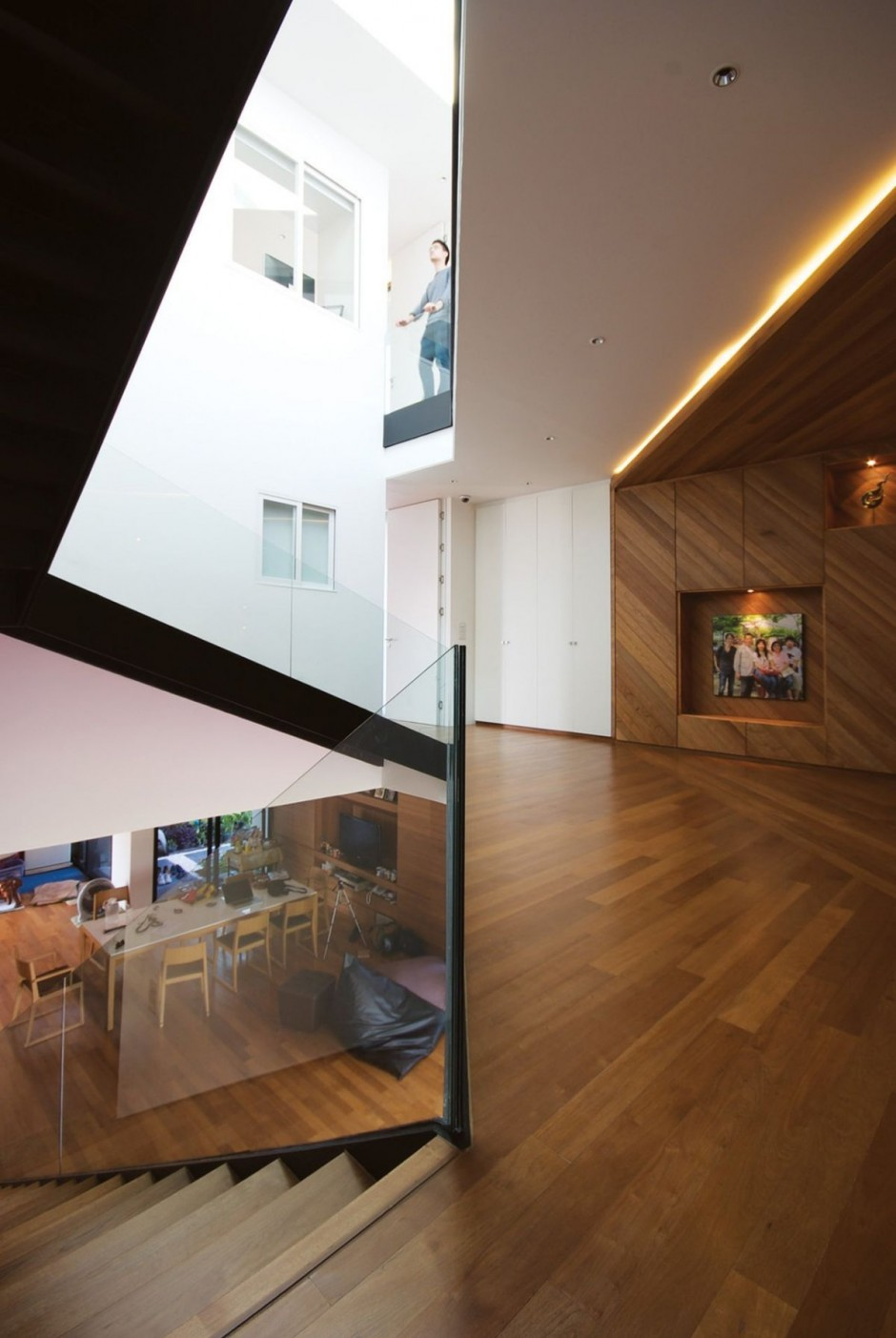Enhanced with Dark Wooden Floor White Painted Wall and Transparent Glass Wall