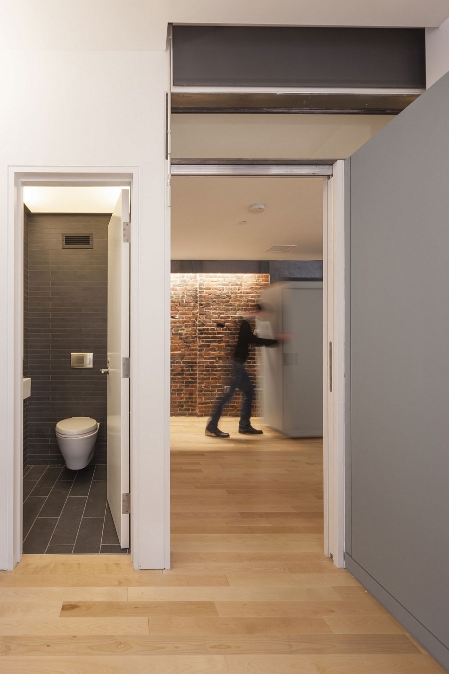 Hallway Wooden Flooring and White Wall s