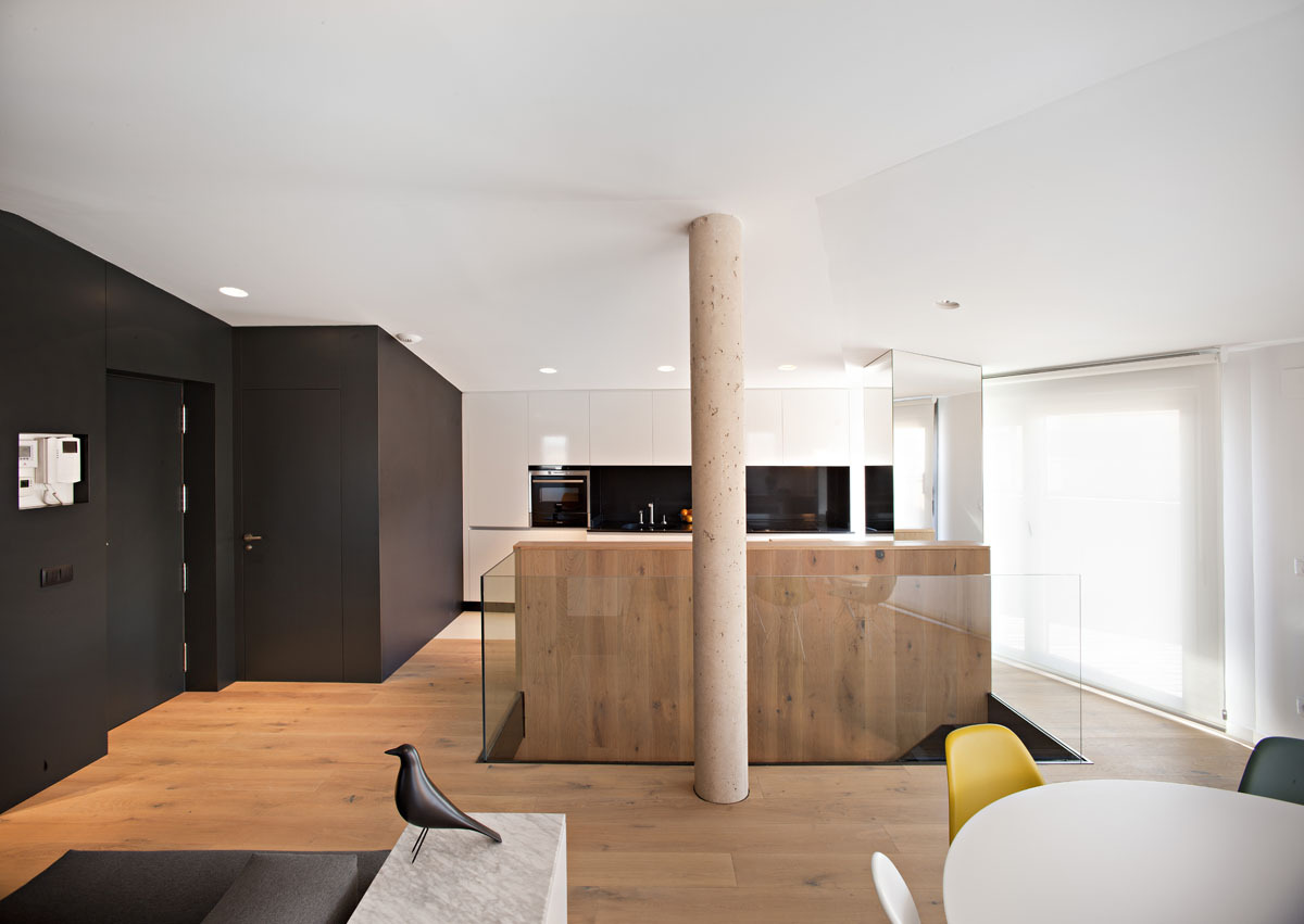 Hardwood Floor and White Ceiling near the Black Wall