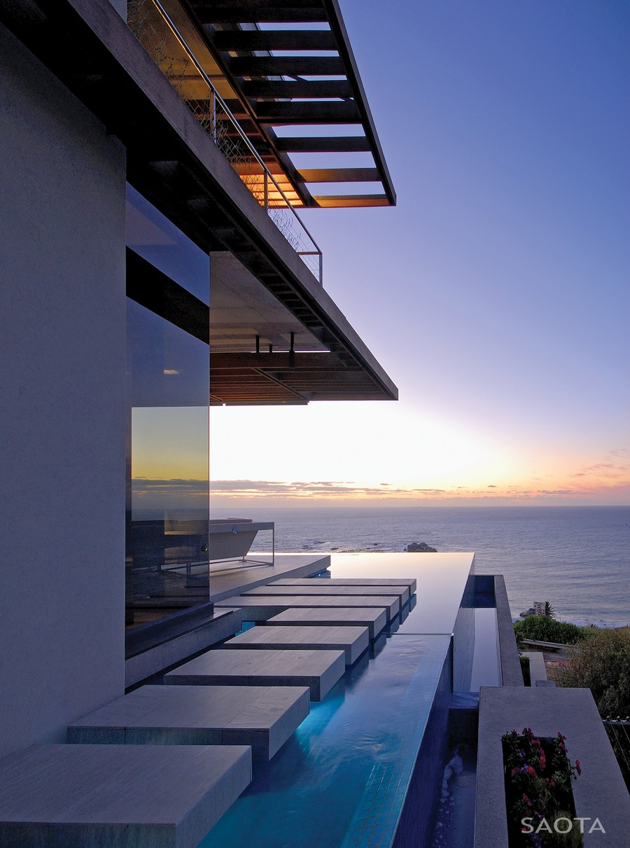 Home Infinity Swimming Pool with Floating Pathway Overlooking Ocean
