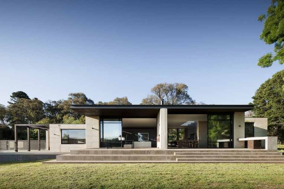 House Daylight View with Simple Open Dining Space and Concrete Floor