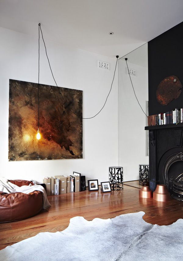 House Space with Black Fireplace and Wide Mirror under White Ceiling