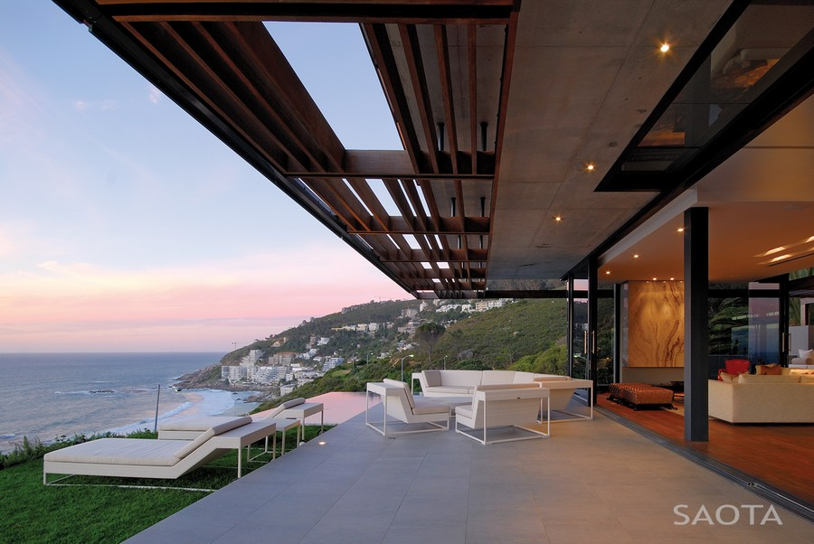 House Terrace Furnished with White Outdoor Furniture