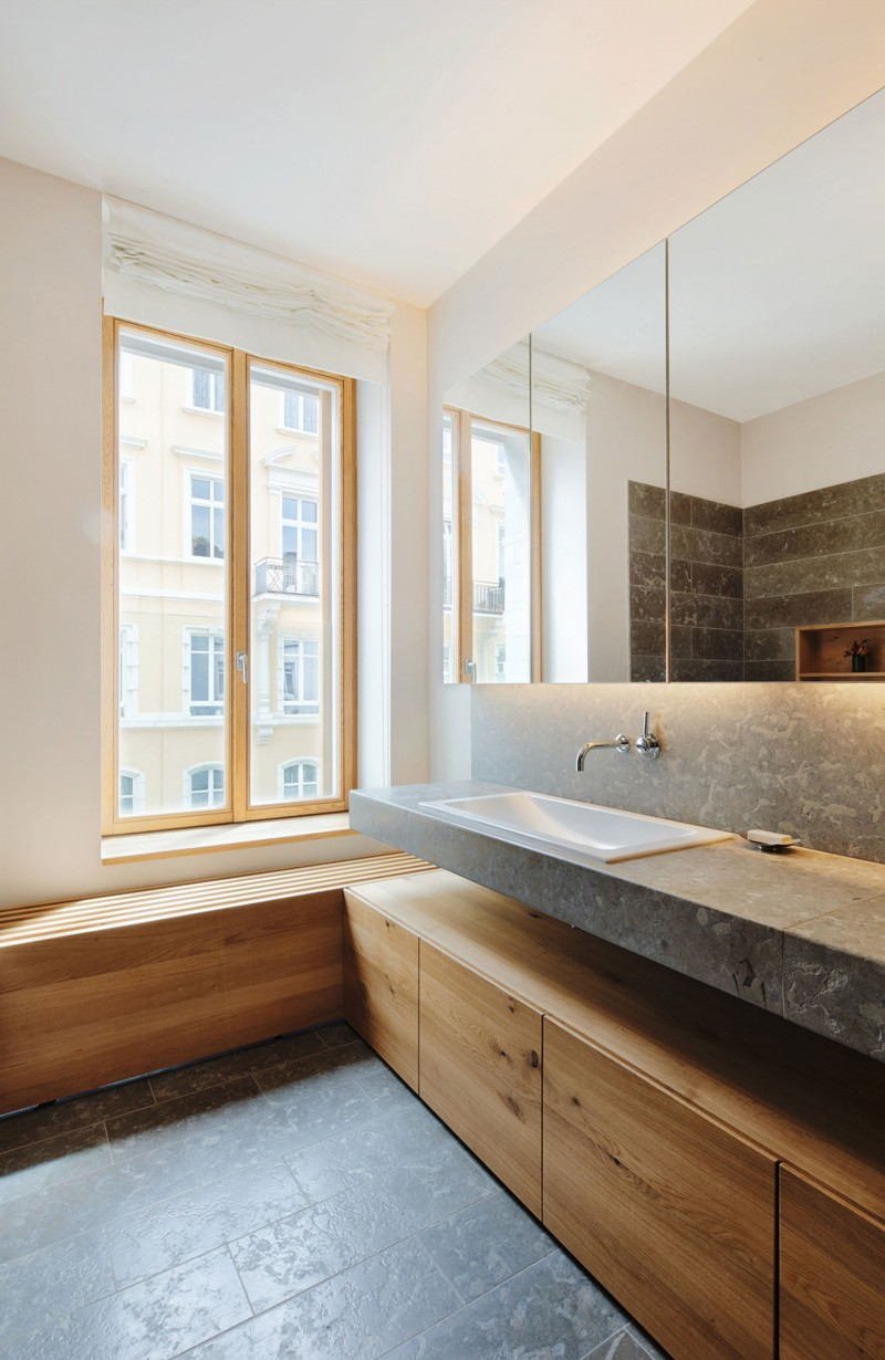 Interior Furnished with Wooden Cabinet Installed under Floating Stone Vanity