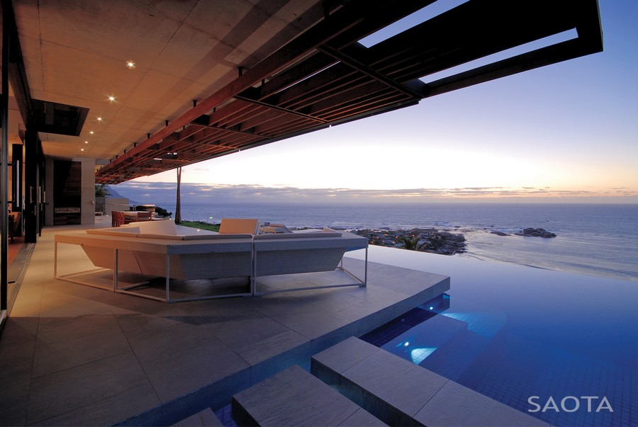 Iron Placed in Home Swimming Pool Side for Enjoying View