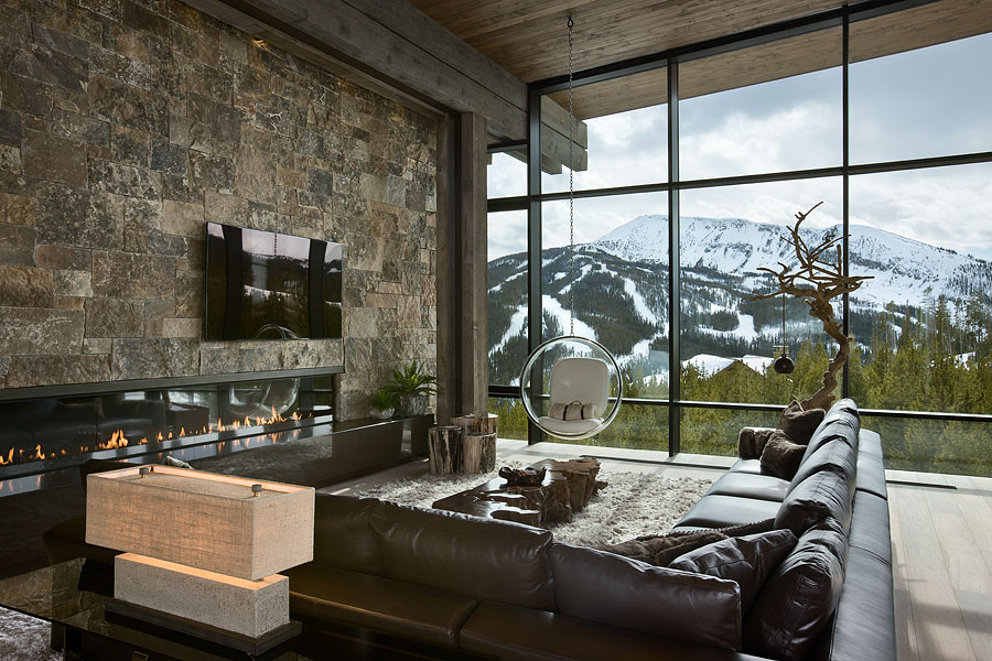 Interior, horizontal, living room toward fireplace looking out windows with view of Pioneer Mountain, Taylor residence, Yellowstone Club, Big Sky, Montana; Reid Smith Architect; LC2 Design Services; Teton Heritage Builders; Montana Reclaimed Lumber