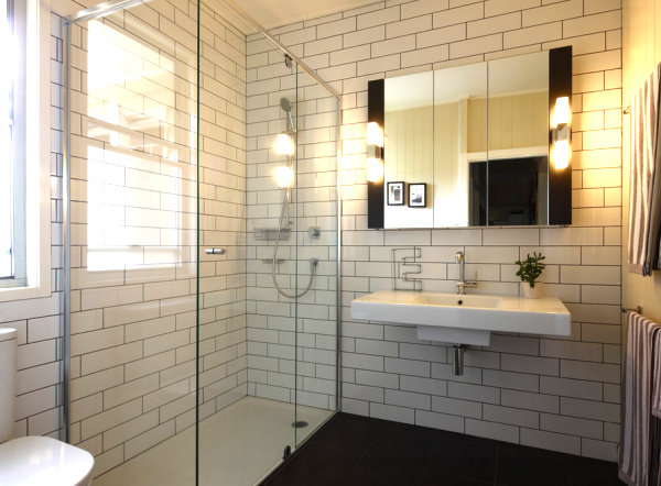 Minimalist bathroomBrick Wall in White Color and Glass Shower s