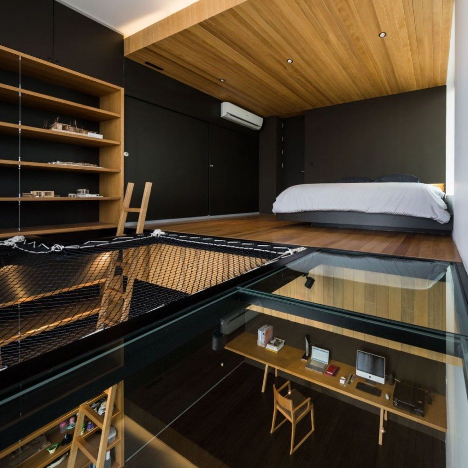Moom Interior Displaying Bedroom Loft and Workspace Located under It