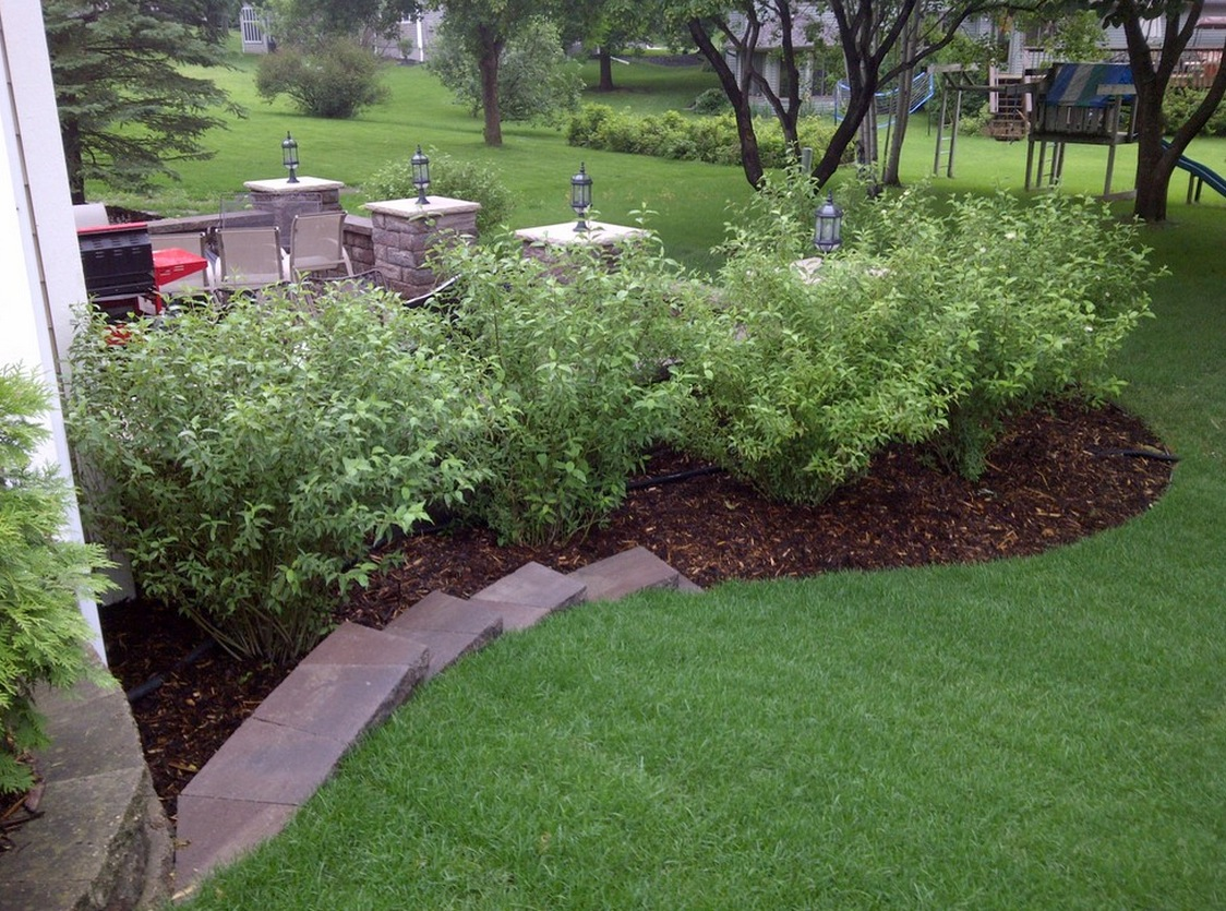Naturally Covering Front Landscape with Outdoor Lamps