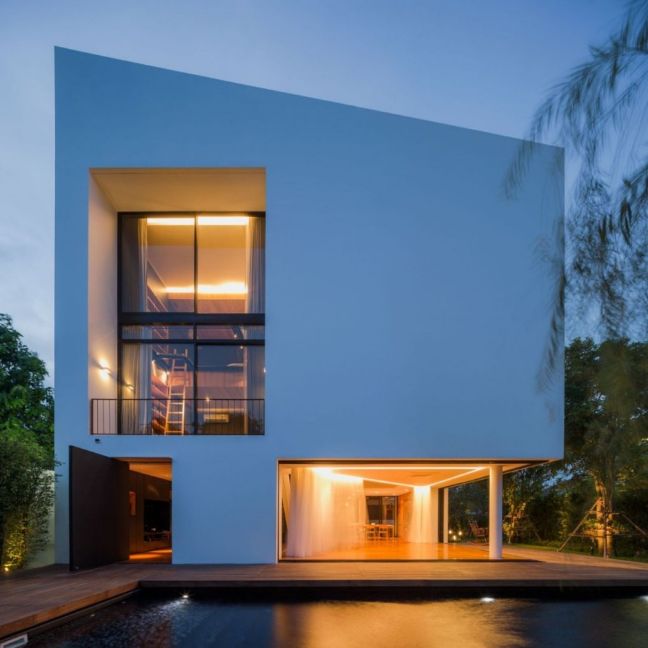 Residence Baan Moom Building Featured with Glass Transparency and Golden Lighting