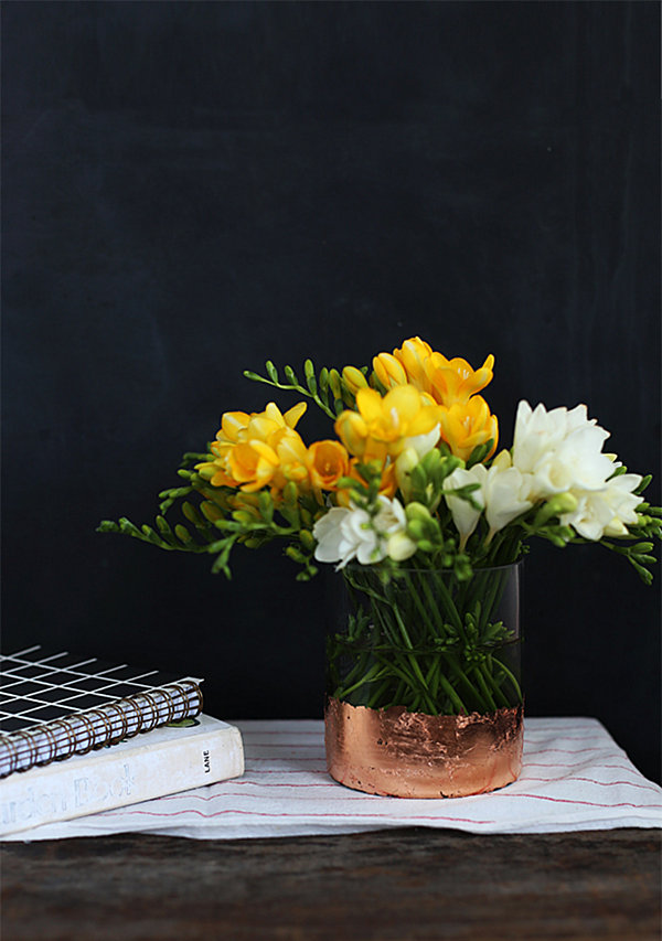 Several Colorful Flowers Placed in Glass Panel Vase with Golden Bottom