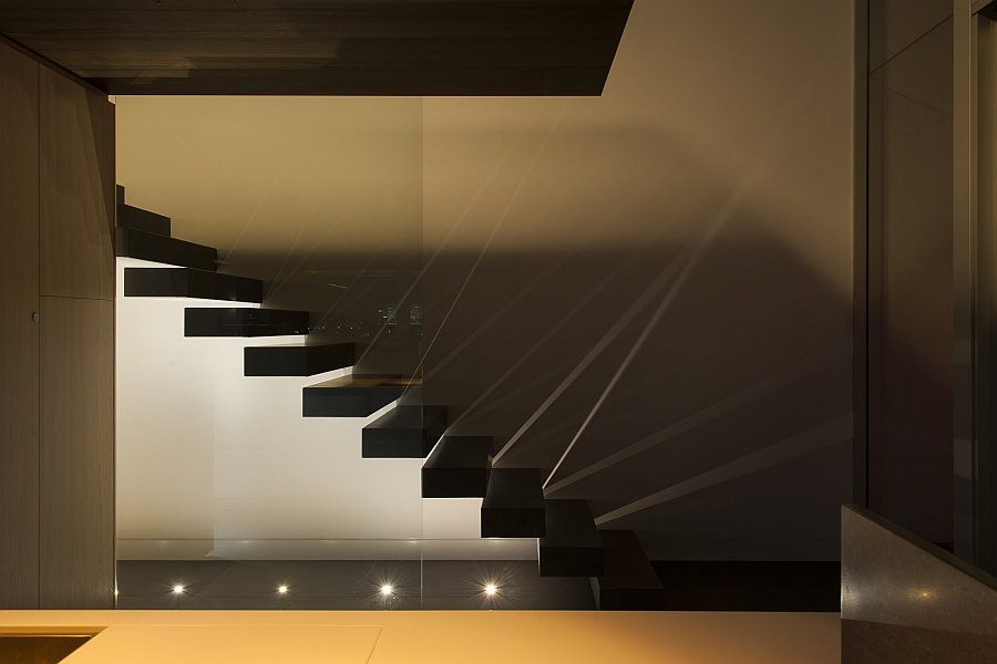 Stairs which is Made from Wooden Blocks and Bright Cream Lighting from the Floor