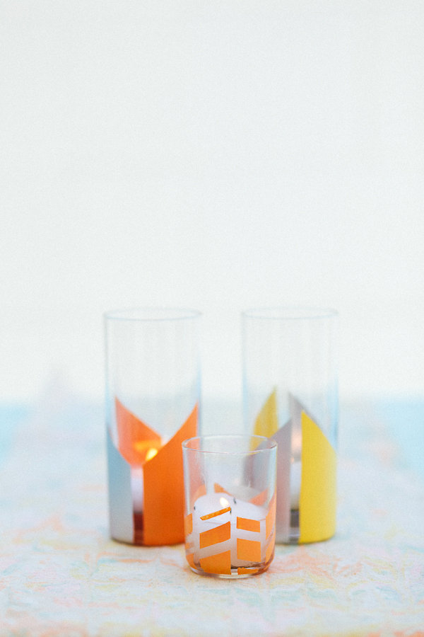 Transparent Glass Material with Colorful Outer Pattern Filled with White Colored Candle