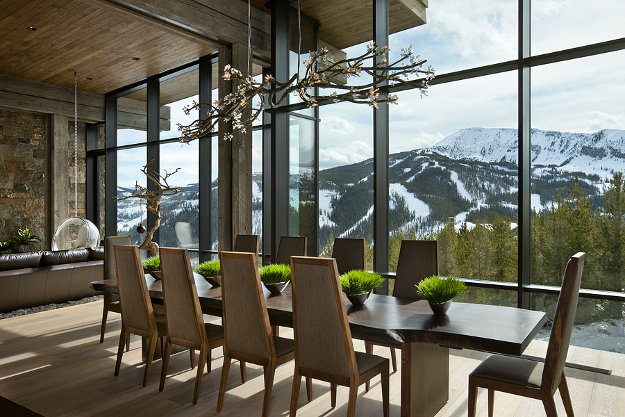 Interior, horizontal, dining room looking out windows with view of Pioneer Mountain, Taylor residence, Yellowstone Club, Big Sky, Montana; Reid Smith Architect; LC2 Design Services; Teton Heritage Builders; Montana Reclaimed Lumber