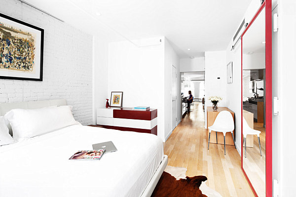 White Bed Linen White Blanket and White Wall Made from Stone Veneer