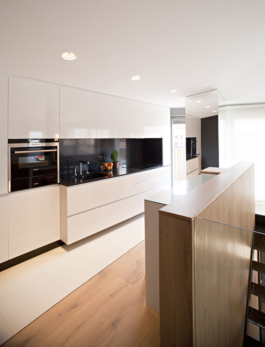 White Drawers and Black Backsplash under the Bright Lamps