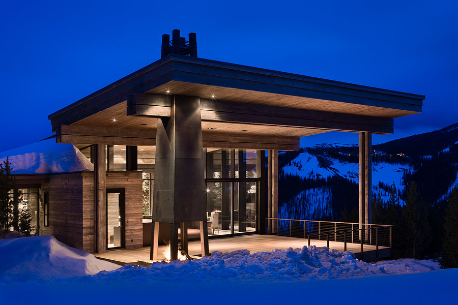 Exterior, horizontal, covered deck with fireplace at twilight, Taylor residence, Yellowstone Club, Big Sky, Montana; Reid Smith Architect; LC2 Design Services; Teton Heritage Builders; Montana Reclaimed Lumber