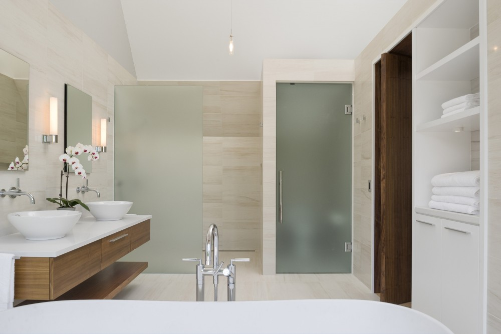 Bathroom with White Towel Shelves and White Cabinet near the Wooden Vanity