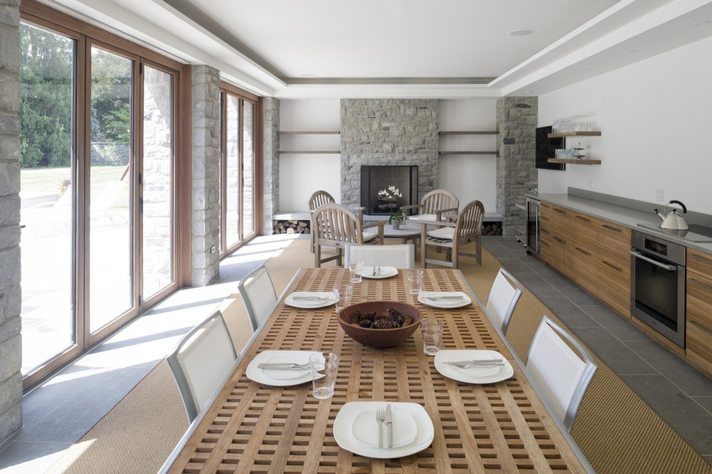 Table and many White Chairs near the Long Wooden Kitchen Counter