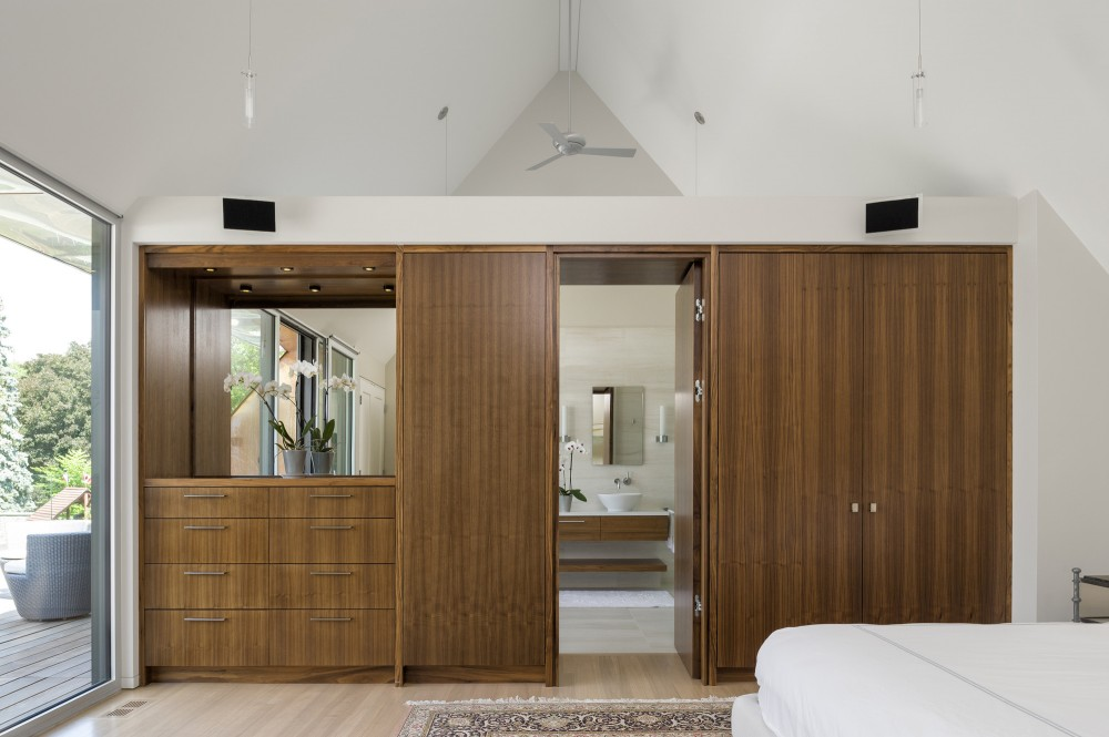 Wooden Cabinets and Wooden Drawers near the Bathroom Small Wooden Door